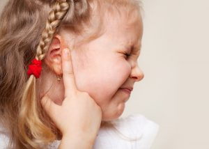child suffering ear infections