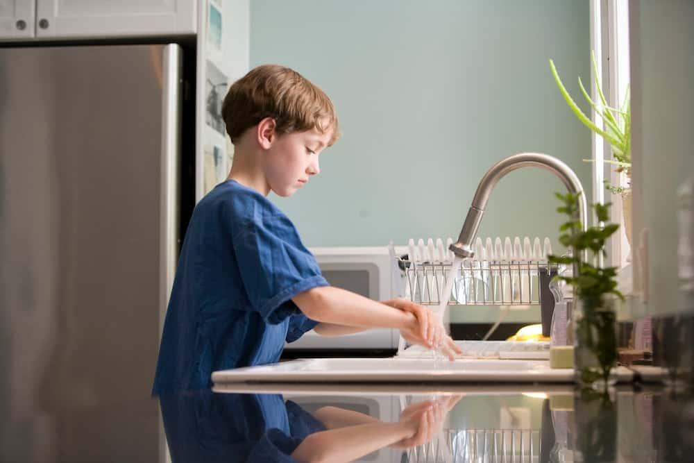 boy washing hands to prevent respiratory illnesses